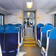 Stock Photo: Rows of seats in passenger train car.