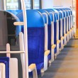 Rows of seats in a passenger train car. — Stock Photo