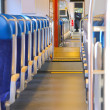 Stock Photo: Rows of seats in a passenger train car.