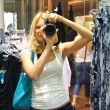 Girl photographs at the mall — Stock Photo
