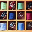 Large selection of ties and belts on sale — Stock Photo #35576803