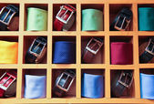 Large selection of ties and belts on sale — Stock Photo