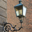 Lamp in retro style on brick wall. Netherlands — Stock Photo #36617619