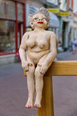 Figurine of a naked woman seated on the railing in Dordrecht, — Stock Photo