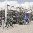 Plenty bicycles at parking lot in Delft, Netherlands — Stockfoto #39996105