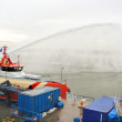 Stock Photo: Ship melts ice by steam gun in harbor of Gorinchem