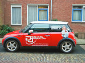 Advertisement on a car that stands in the street in Gorinchem. N — 图库照片