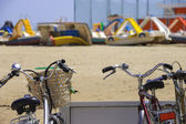 Bikes on the beach parking lot on a sunny day — Stock Photo