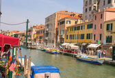 Active movement on a canal in sunny spring day,Venice, Italy — Stock Photo
