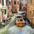 People in boats  move along a canal in Venice, Italy  — Stockfoto #49510459