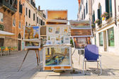 Equipment and drawings street artist in Venice, Italy — Stock Photo