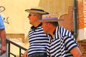 Two gondolier on the docks awaiting tourists in Venice, Italy  — Stock Photo