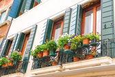 Picturesque Italian house with flowers on the balconies  — Stock Photo