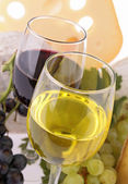 Wineglass and cheese — Stock Photo