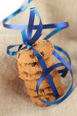 Gourmet cookies with blue ribbon — Stock Photo