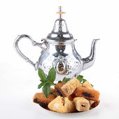 Teapot and pastry — Stock Photo