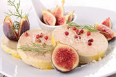 Plate with foie gras and fresh fig — Stock Photo