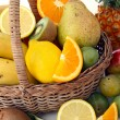 Wicker basket with fruits — Stock Photo #13423323