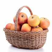 Wicker basket with apples — Stock Photo