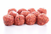 Raw meatballs on white background — Stock Photo