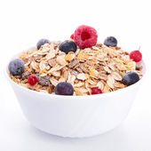 Bowl of cereals and berries fruits — Stock Photo
