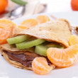 Stock Photo: Crepe with chocolate and clementine