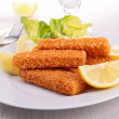 Fish fingers with garnish — Stock Photo