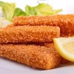 Fish fingers with garnish — Stock Photo