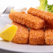 Fish fingers with garnish — Stock Photo #18922415