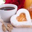 Coffee and heart shape biscuit — Stock Photo
