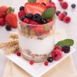 Yoghurt, cereals and fruits - Stock Photo