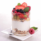 Yoghurt, cereals and fruits — Stock Photo