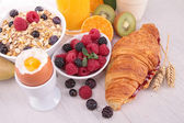 Breakfast with egg,croissant,drinks and fruits — Stock Photo