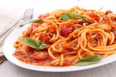 Plate of spaghetti and tomato sauce — Stock Photo