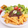 Beefsteak with lettuce and fries — Stock Photo #20566783