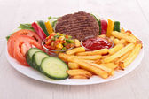Plate of vegetables fries and beefsteak — Zdjęcie stockowe