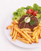 Plate of french fries and beefsteak — Stock Photo