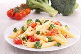 Pasta with tomato and broccolis — Stock Photo