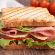 Sandwich on wood background — Stock Photo #22129945