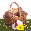 Easter egg in wicker basket with flower — Stock Photo #22284781