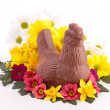 Chocolate bell and flowers — Stock Photo