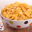 Bowl of corn flakes cereal — Stock Photo #22591569