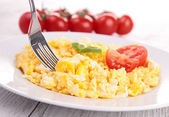 Scrambled egg with toast and tomato — Stock Photo