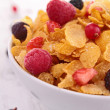Bowl of cereals and fruits — Stock Photo