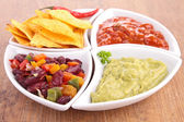 Assortment of dips and tortillas chips — Stock Photo
