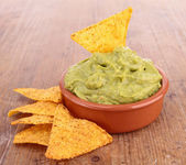 Corn tortillas chips and guacamole — Stock Photo