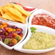 Assortment of mexican dips — Stock Photo