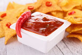 Spicy tomato sauce and tortilla chips — Stock Photo