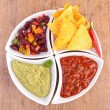 Bowl of assortment of dips and tortilla chips — Stock Photo #23713891