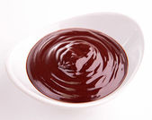 Bowl of chocolate sauce — Stock Photo